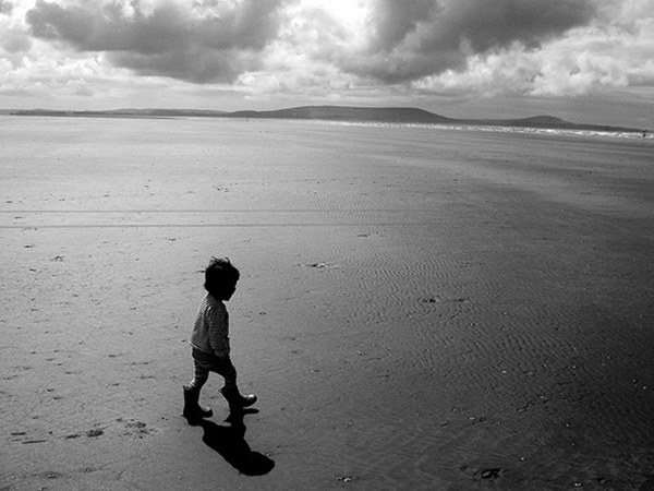 child-walking-on-beach