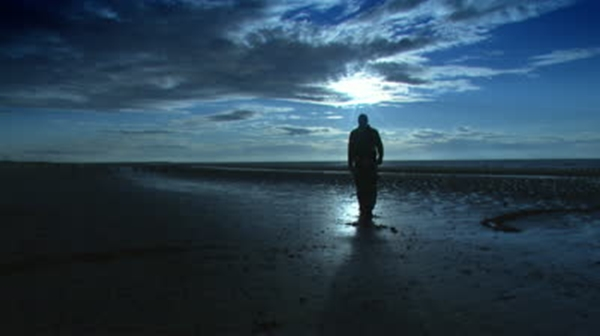 stock-footage-man-walking-on-the-beach-at-night