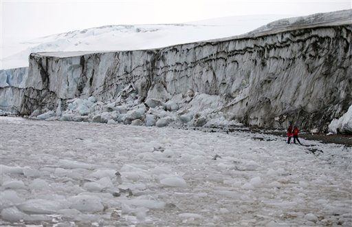 In this Jan. 26, 2015 photo, Chilean biochemist Jenny Blamey, far right, walks with a member of her team in search of extreme organisms in Punta Hanna on Livingston Island, part of Antarctica's South Shetland Island archipelago. Deep below the ice is a cold and barren world that by all indications should be completely void of life. But recently, scientists researching melting ice discovered fish and shrimp-like creatures. And in areas that haven't been exposed to sunlight for millions of years, scientists found a surprise: the DNA of a microscopic creature that looks like a combination of a bear, manatee and centipede. (AP Photo/Natacha Pisarenko)